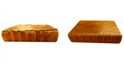 Livre datant de 1655 avant et après restauration